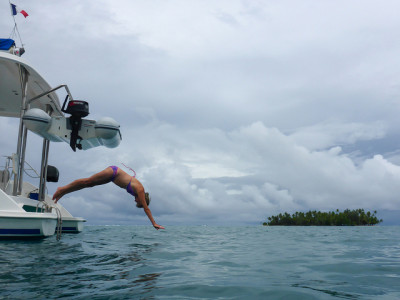 Diving from the stern of a boat in Tahaa, Society Islands, French Polynesia - photo by Roger