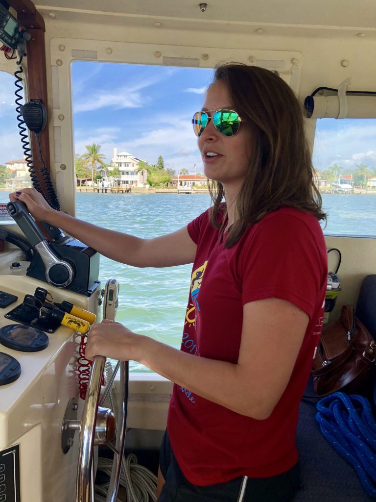 kelsey albina driving boat